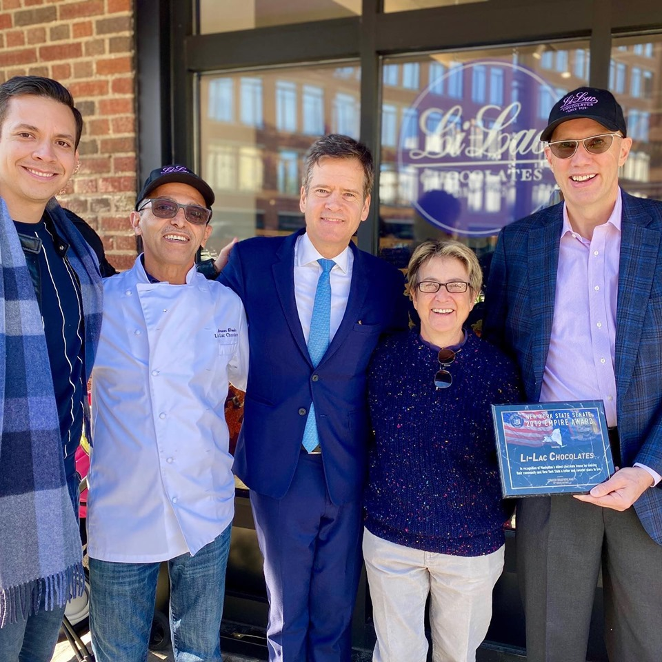 At the grand opening of Li-Lac Chocolates on Greenwich Ave., from left,Andres Pazmino, president of the Greenwich Village-Chelsea Chamber of Commerce; Anwar Khoder, a co-owner of Li-Lac Chocolates; state Senator Brad Hoylman; Assemblymember Deborah Glick; and Christopher Taylor, a Li-Lac Chocolates co-owner.